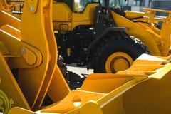 Maskin för grävskopaladdare Sidosikt av Front Hoe Loader industriellt medel Maskin för tung konstruktionsutrustning Pneumatisk la arkivbild