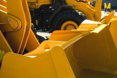 Maskin för grävskopaladdare Sidosikt av Front Hoe Loader industriellt medel Maskin för tung konstruktionsutrustning Pneumatisk la royaltyfri bild