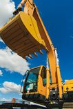 Maskin för grävskopaladdare Sidosikt av Front Hoe Loader industriellt medel Tung utrustningmaskin Pneumatisk lastbil fotografering för bildbyråer