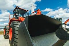 Maskin för grävskopaladdare Sidosikt av Front Hoe Loader industriellt medel Tung utrustningmaskin Pneumatisk lastbil Constructio arkivbild