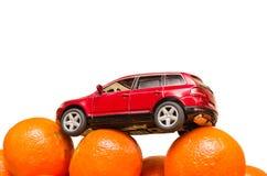 Maskin på orange apelsiner Arkivfoton