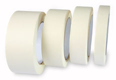 Masking tape - paper Krepp tape, cream white masking tape, four. Crepe-adhesive tape, Masking tape, white, paper, four are on the side of the roll, isolated on Stock Images