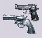 Maskinpistol och revolver. Arkivbilder