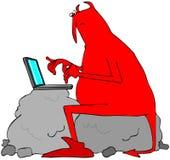 Maskinskrivning för röd jäkel på en bärbar datordator Royaltyfri Foto