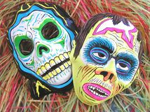 Masks. Two scary masks, one of a skeleton, one of a monster Royalty Free Stock Image
