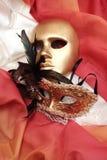 Masks. Golden venetian masks on a textile Stock Photo