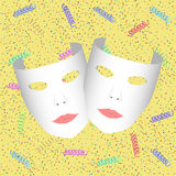 Masks. On a yellow background with confetti and silly string Stock Photo