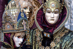 Masks in beautiful costumes at Carnival in Venice Stock Image