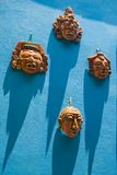 Masks on blue wall Royalty Free Stock Image