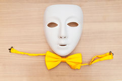 Masks and bow ties on the wood Stock Image