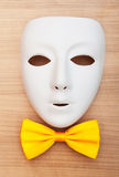 Masks and bow ties on the wood Royalty Free Stock Photo