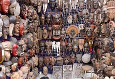 Masks. A bunch of wooden tribal african Xhosa and Zulu masks at Greenmarket, Cape Town, South Africa royalty free stock photos