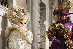 Masks of the carnival. Two well dressed masks from the Venice carnival both looking into the camera Stock Image