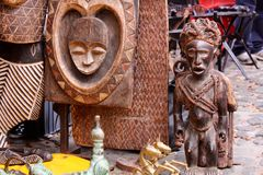 Masks. Close up of many tribal african Xhosa and Zulu wooden sculptures at Greenmarket, Cape Town, South Africa royalty free stock photos
