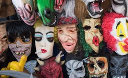 Masks collection. Halloween masks in street shop Stock Photos
