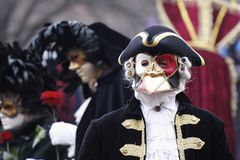 Masks and costumes. Historic carnival with masks and costumes Stock Photo