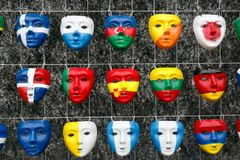 Masks in the form national flags of countries. All over the world Stock Photos