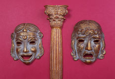 Masks of the Greek theater. Representing joy and sadness, between a column of the same style stock photos