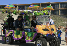 Masks, Green, Gold and Purple Decorate a Golf Cart at the Barefoot Mardi Gras Parade Royalty Free Stock Image