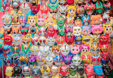 Masks hang in a booth at Amarin temple festival in Bangkok Stock Images