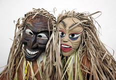Masks of indigenous people. People wearing masks of indigenous people royalty free stock photos
