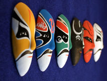 Masks in a line royalty free stock photos