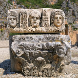 Masks and Lycian tombs Stock Photo