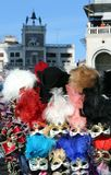 Masks for sale and the clocktower in saint mark square Royalty Free Stock Photo