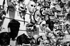Masks on sale on a wall in a shop Stock Photo