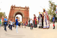 Masks supporting independence of Catalonia by Arc de Triomf in Barcelona. People in big tall masks of traditional Catalan figures  supporting independence of Royalty Free Stock Photography