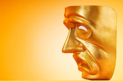 Masks with the theatre concept. On the background Royalty Free Stock Images