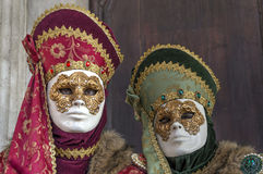 Masks at Venice Carnival. Traditional masks posing in San Marco Square, Venice, Italy Royalty Free Stock Image