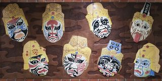 Masks on a wall in the subway Royalty Free Stock Photo