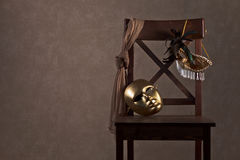 Masks on  wooden chair Royalty Free Stock Photography