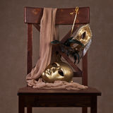 Masks on  wooden chair Royalty Free Stock Images