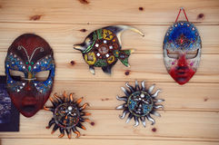 masks. Different types of masks on a wooden wall Stock Photos