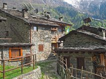 Maslana is an ancient rural village accessible only on foot. Valbondione, Bergamo, Orobie Alps, Italy. Maslana is an ancient rural and old village accessible Stock Photos