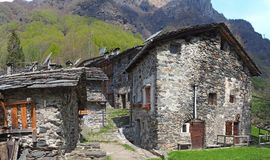 Maslana is an ancient rural village accessible only on foot. Valbondione, Bergamo, Orobie Alps, Italy. Maslana is an ancient rural and old village accessible Stock Image