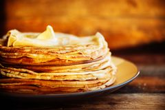 Pancakes with banana, nuts and honey. Traditional Russian cuisine. Maslenitsa. Dessert. royalty free stock image
