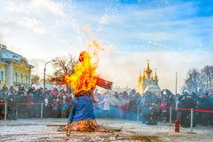 Maslenitsa celebration. ST PETERSBURG, RUSSIA - February 25, 2017: Burning of a doll during spring holiday of Maslenitsa, an Eastern Slavic religious and folk royalty free stock images