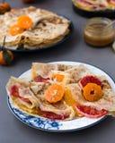 Maslenitsa. Crepe Suzet. Thin pancakes with honey and citrus.  stock photo