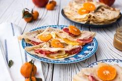 Maslenitsa. Crepe Suzet. Thin pancakes with honey and citrus.  royalty free stock photography