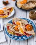 Maslenitsa. Crepe Suzet. Thin pancakes with honey and citrus royalty free stock images