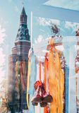 Maslenitsa decorations in front of the store colorful ribbons and red boots. Reflection of the Kremlin Tower in the. Maslenitsa decorations in front of the store royalty free stock photos