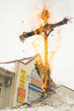 Maslenitsa Doll in fire. PODOLSK, RUSSIA - FEB 26: Unidentified people is fire the Maslenitsa Doll on Russian holiday Maslenitsa on a square in Podolsk city on stock photos