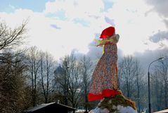Maslenitsa doll and orthorox church cupola. Stock Images