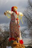 Maslenitsa doll. Trees without leaves background. Stock Photography