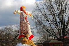 Maslenitsa doll. Trees without leaves background. MOSCOW - MARCH 13, 2016: Maslenitsa doll. Trees without leaves background. Shrovetide (Pancake week) stock photo