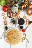 Maslenitsa festival meal. Pancake with caviar and tea. Maslenitsa festival meal. Pancake on white background royalty free stock images