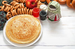 Maslenitsa festival meal. Pancake with caviar and tea. Maslenitsa festival meal. Pancake on white background royalty free stock image
